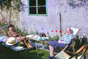 Taking afternoon tea in the back garden by the ancient barn